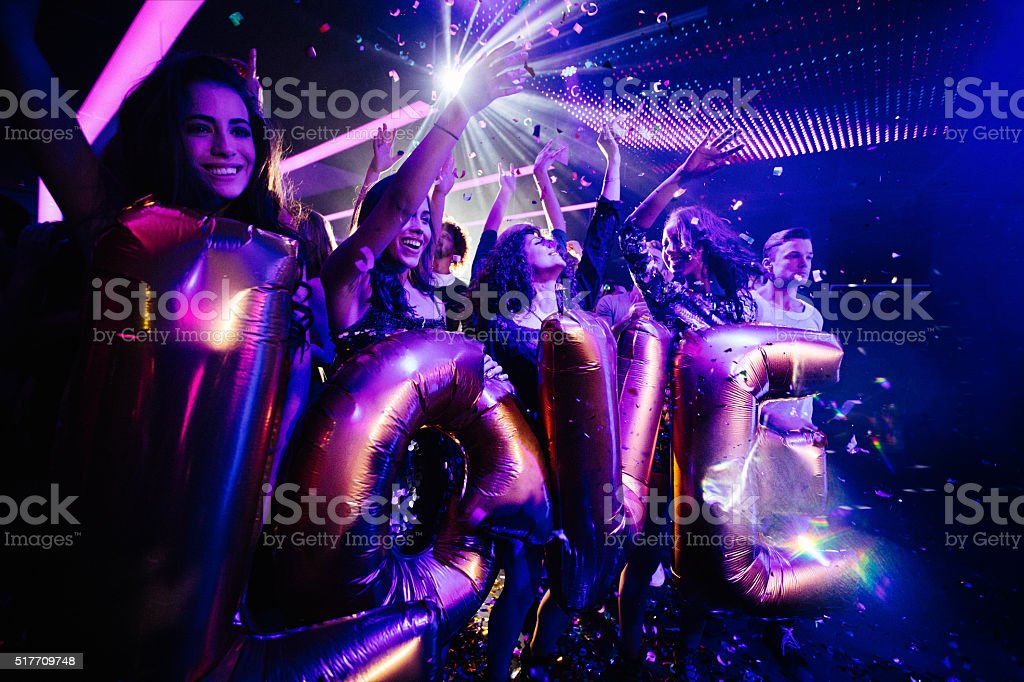 Young fun loving friends celebrating party in a club stock photo