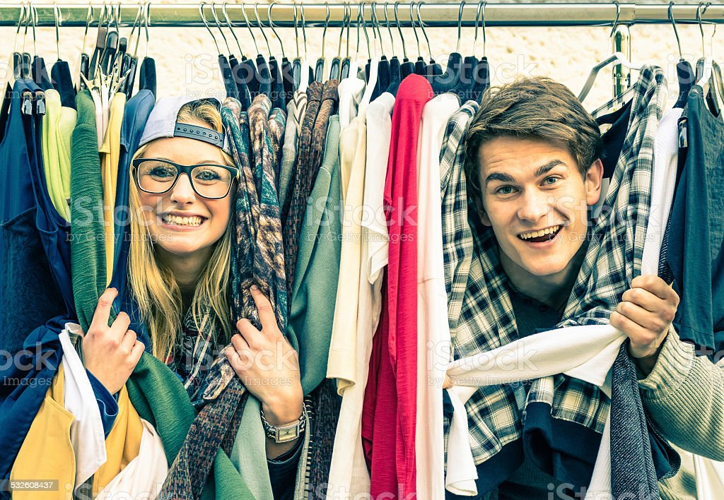 Young funny couple in love at the weekly cloth market stock photo