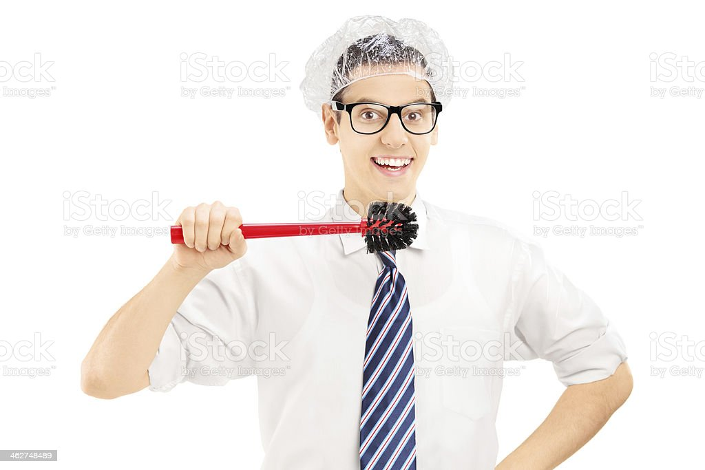 Young funny man holding a toilet brush stock photo