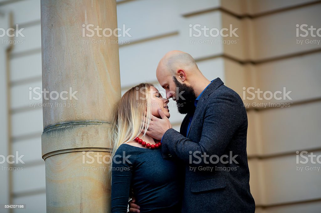 Young funny pretty fashion vintage hipster couple having fun royalty-free stock photo