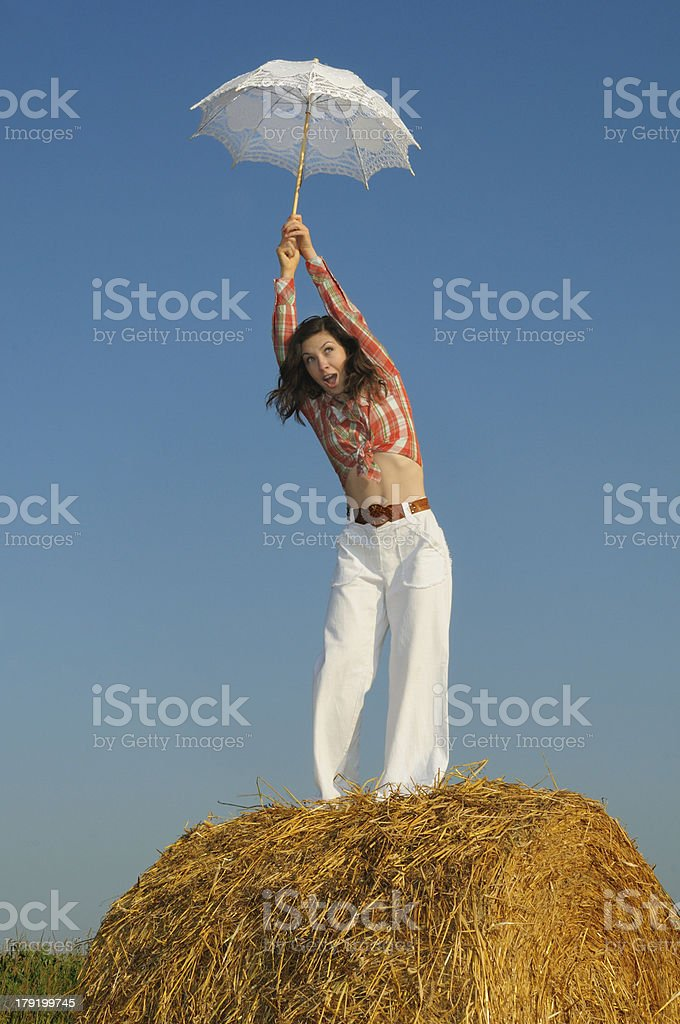 Young funny women on the haystack royalty-free stock photo