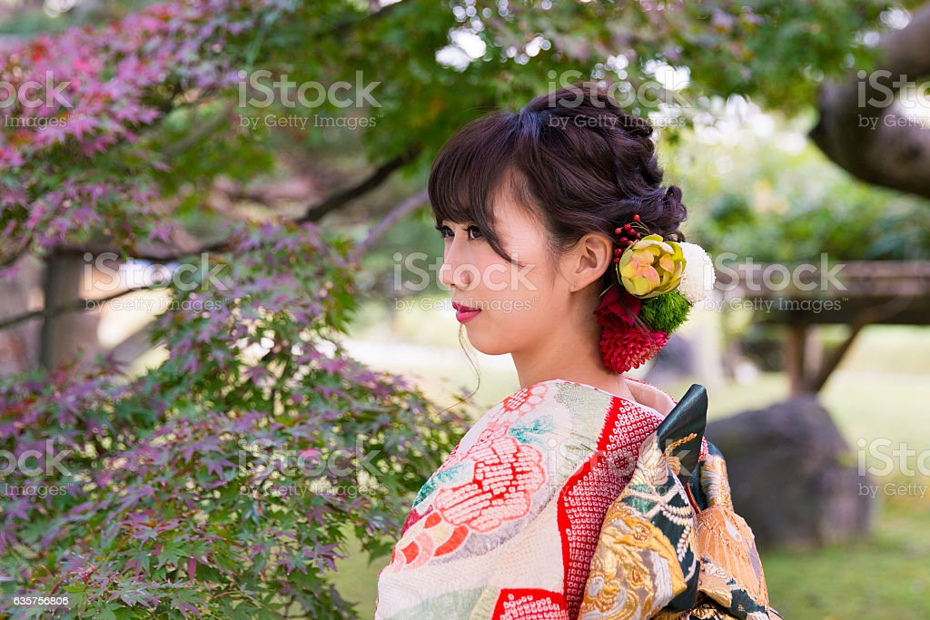 Young Furisode woman in Japanese garden stock photo