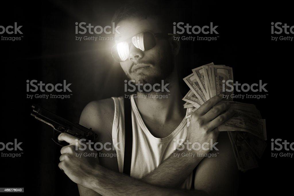 young gangster with US dollar and handgun stock photo