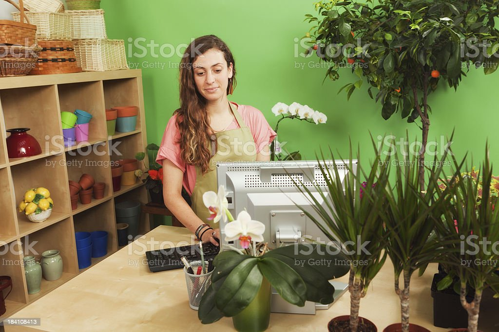 Young Garden Center Entrepreneur Small Business Owner in Her Shop royalty-free stock photo