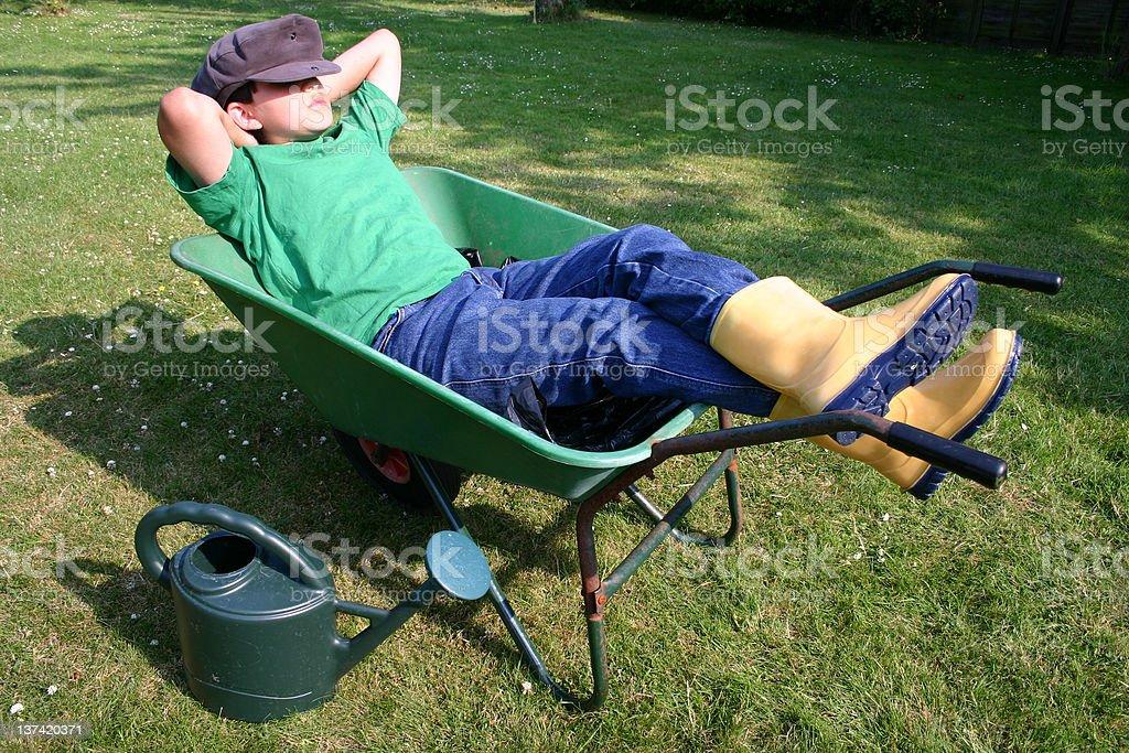 Young gardener having a break stock photo