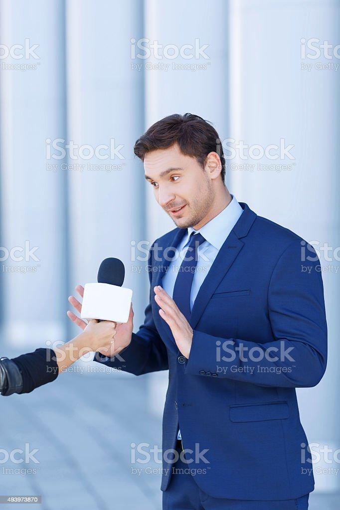 Young gentleman is not willing to speak stock photo