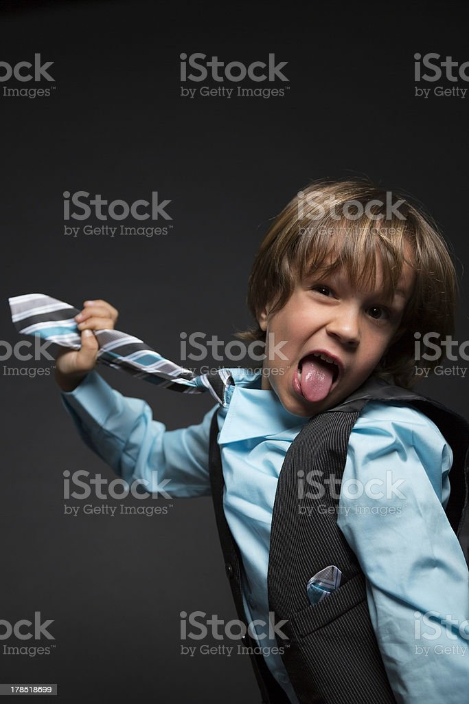 Young gentleman strangled by his tie stock photo