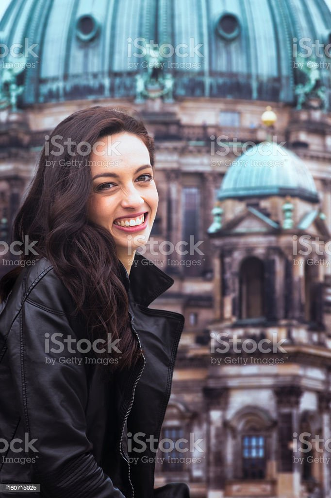 Young German beauty smiling in front of Berlin Cathedral royalty-free stock photo