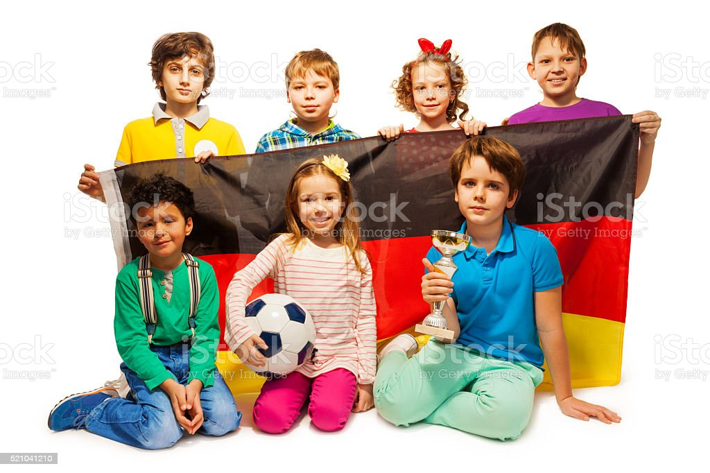 Young German football players with a cup and ball stock photo