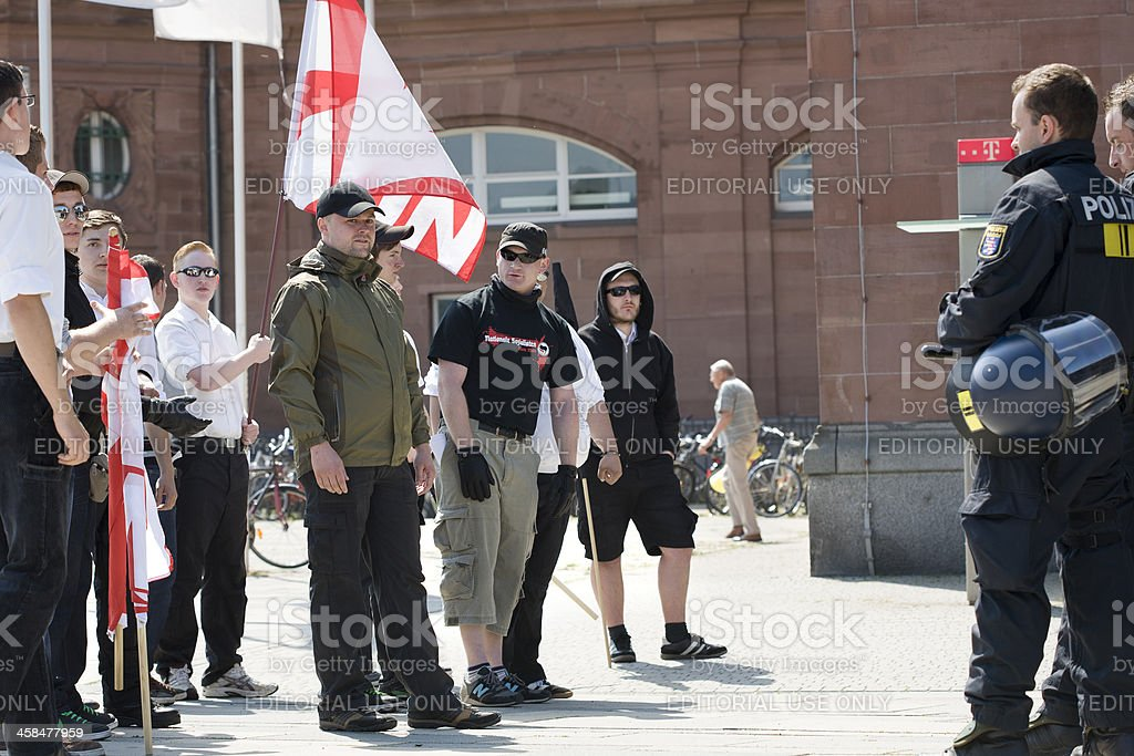 Young german Neonazis against riot police stock photo
