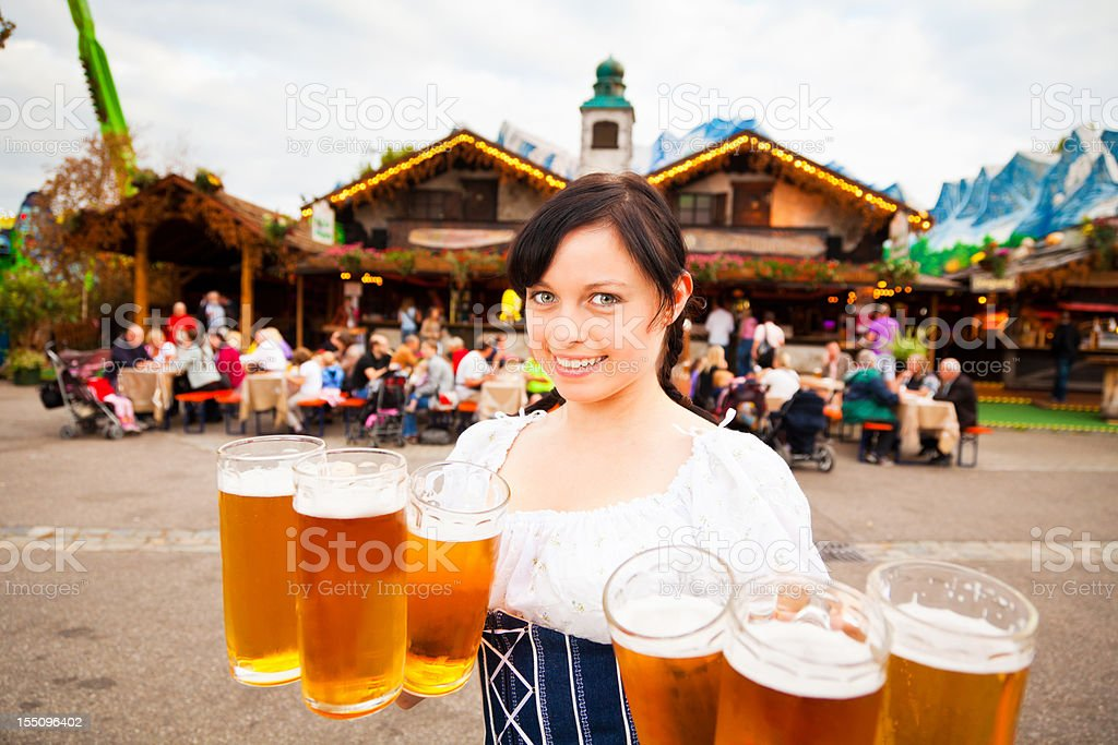 young german woman serving beer royalty-free stock photo