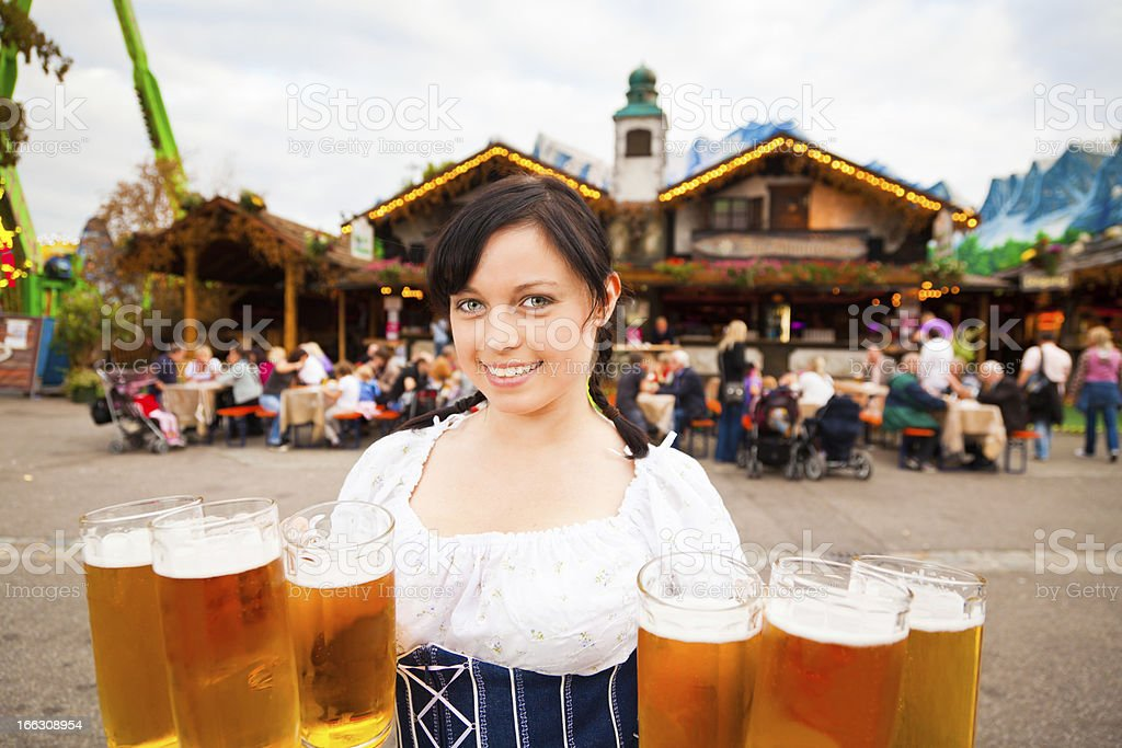 young german woman serving beer stock photo