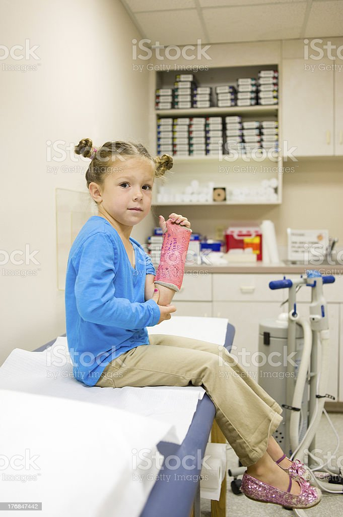 Young Girl a bit Timid Before Having Cast Removed (Series) stock photo