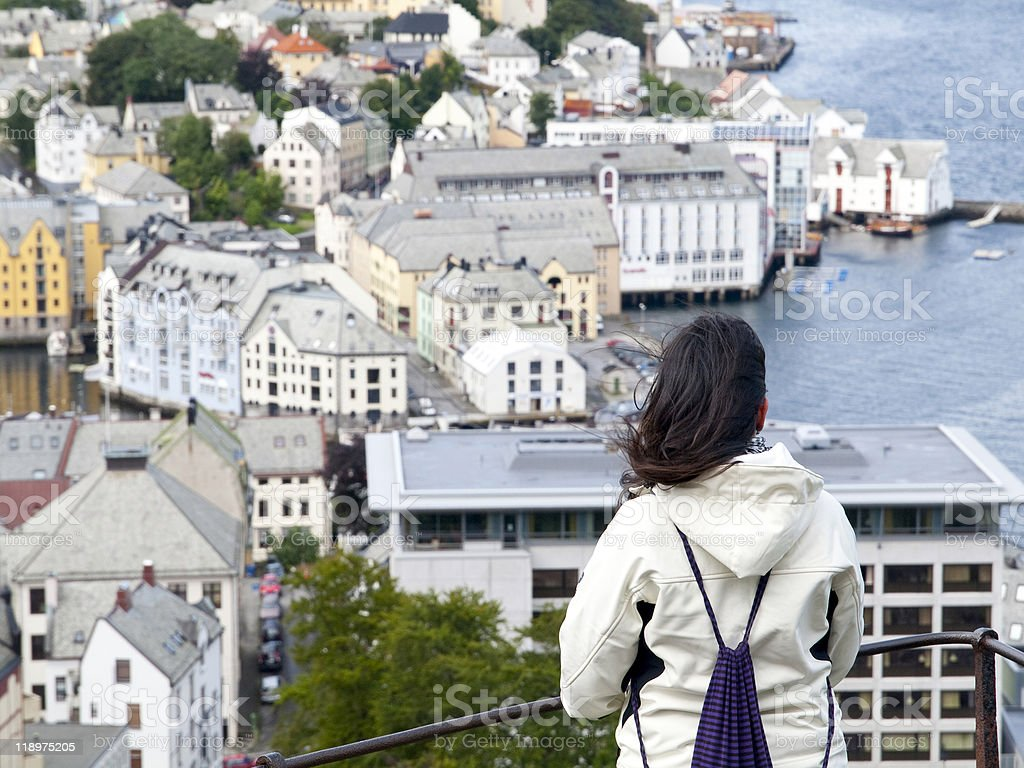 Young girl admiring the city of Alesund stock photo