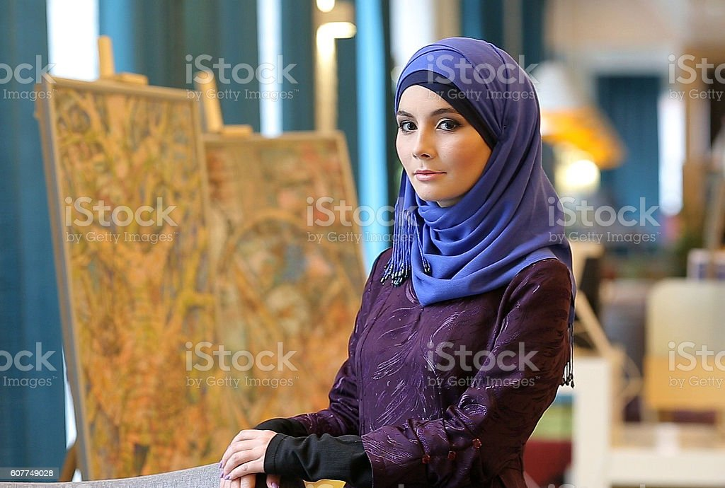 Young Girl Advertises Muslim Clothing stock photo