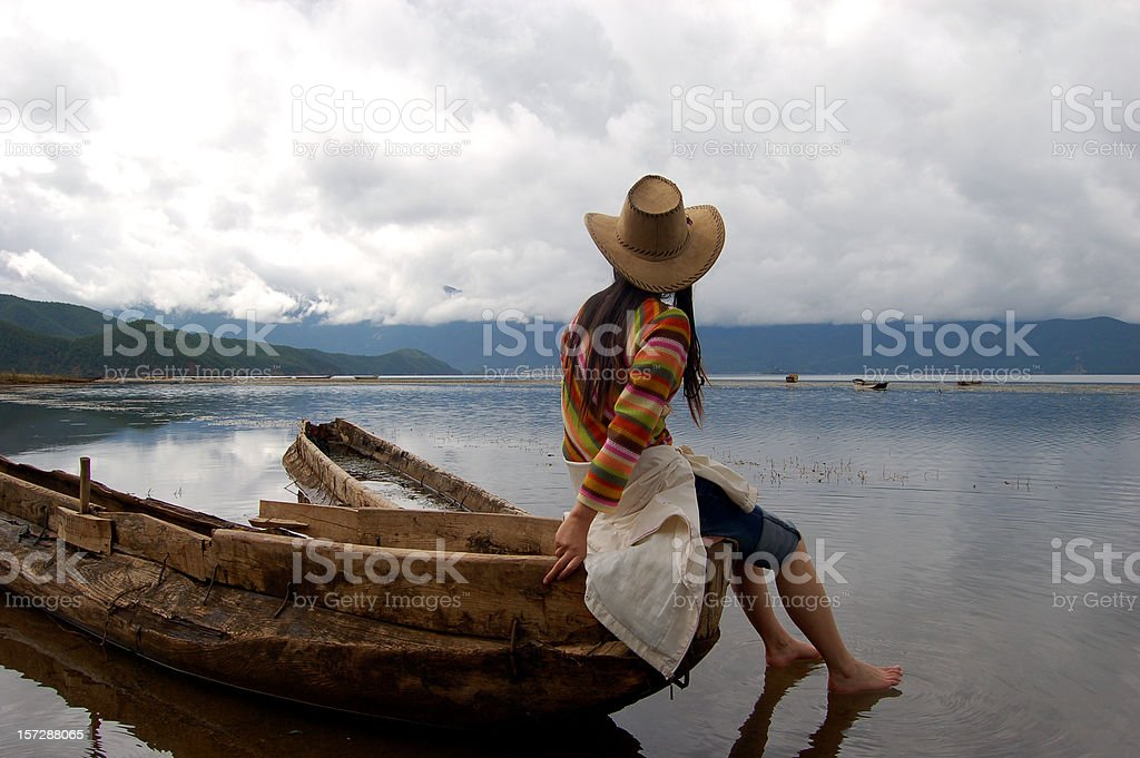 young girl and boat stock photo