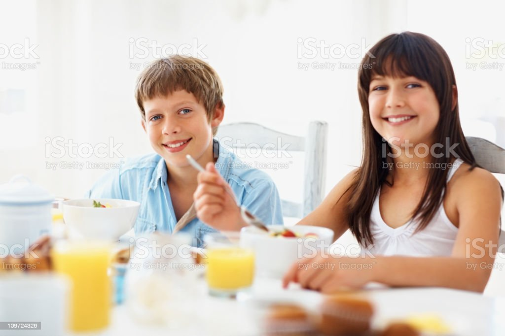 Young girl and boy having a healthy breakfast royalty-free stock photo