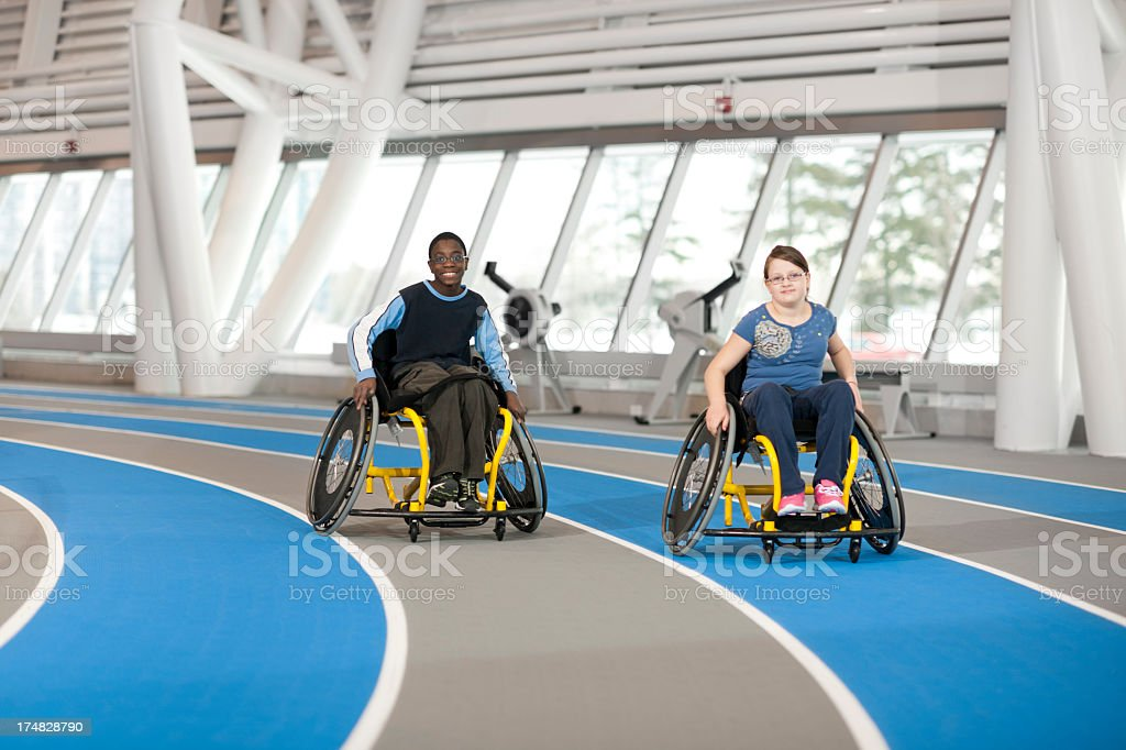 Young Girl and Boy with Disabilites. stock photo