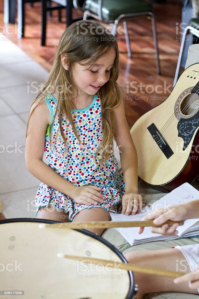 Young girl and drumer stock photo