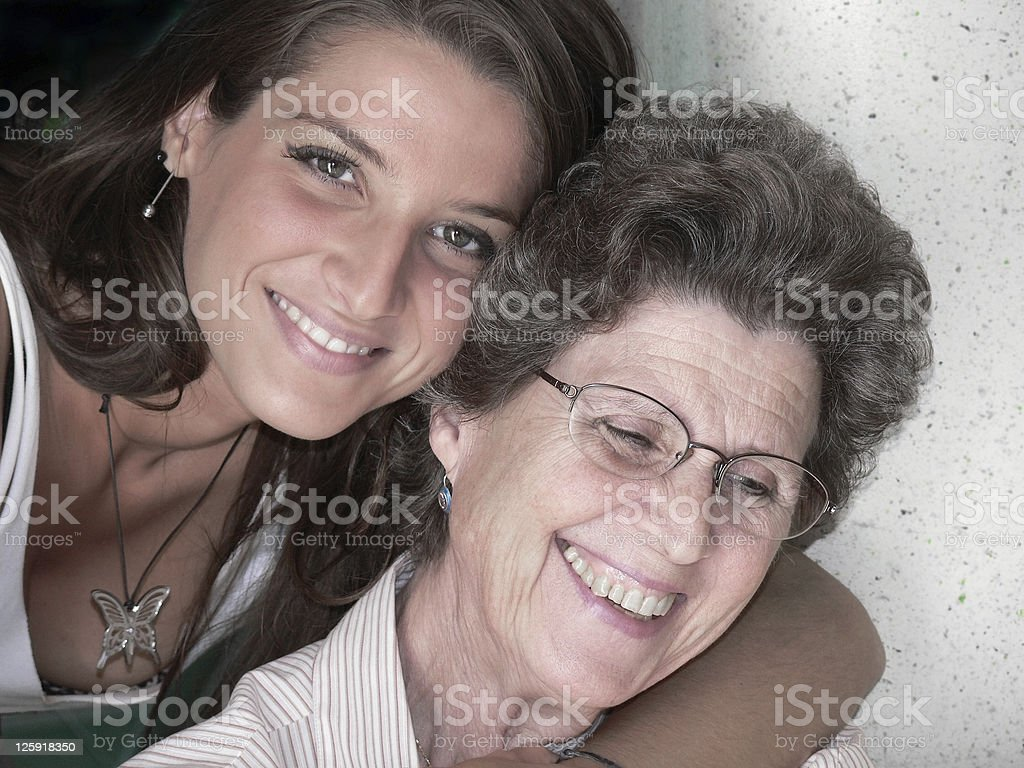 young girl and elderly woman royalty-free stock photo