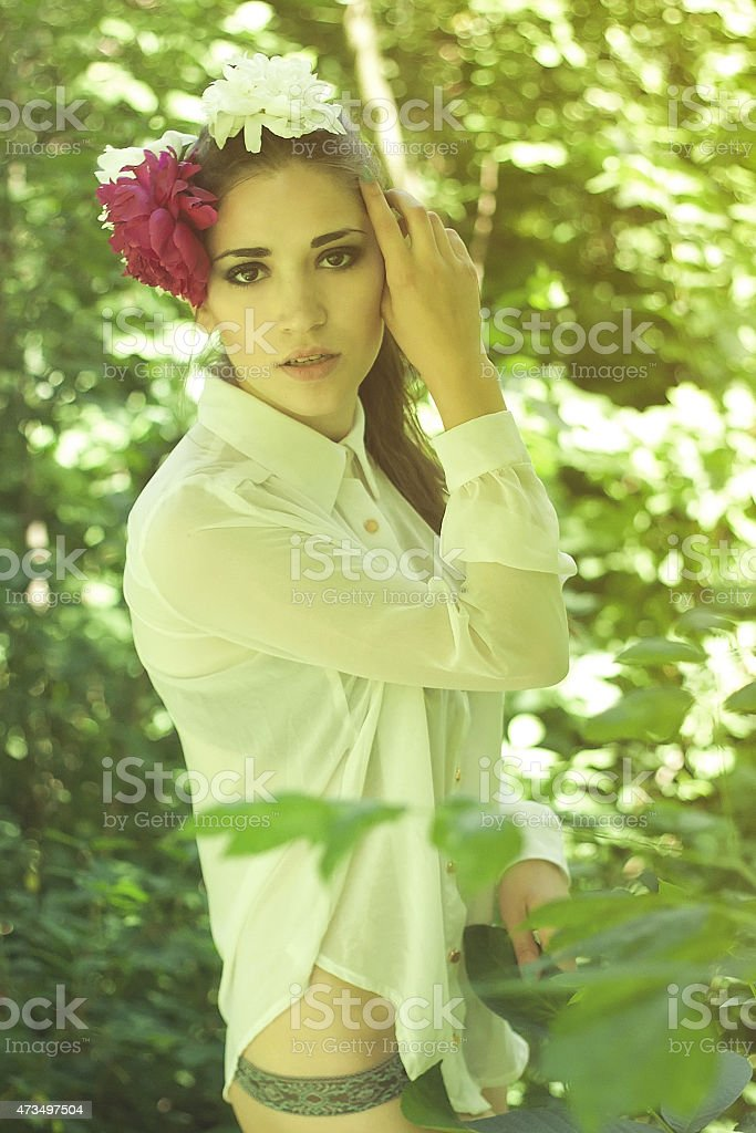 Young girl and  flowers in her hair stock photo