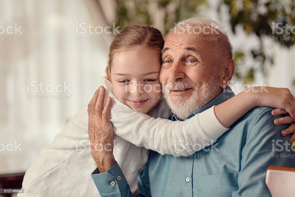 Young girl and grandfather stock photo