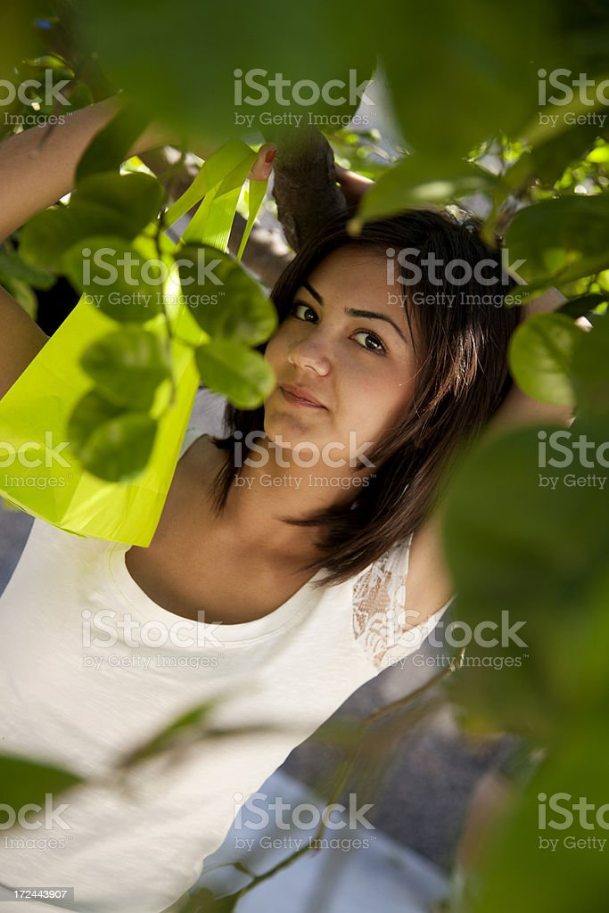 young girl and green shopping bag stock photo
