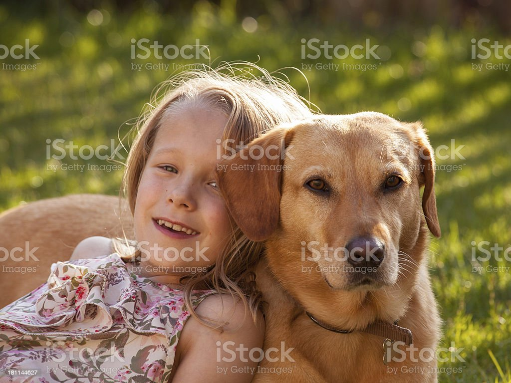 Young girl and her dog relaxing. royalty-free stock photo