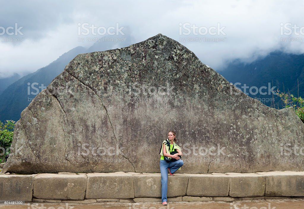 Young girl and Inca Wall in Machu Picchu. stock photo