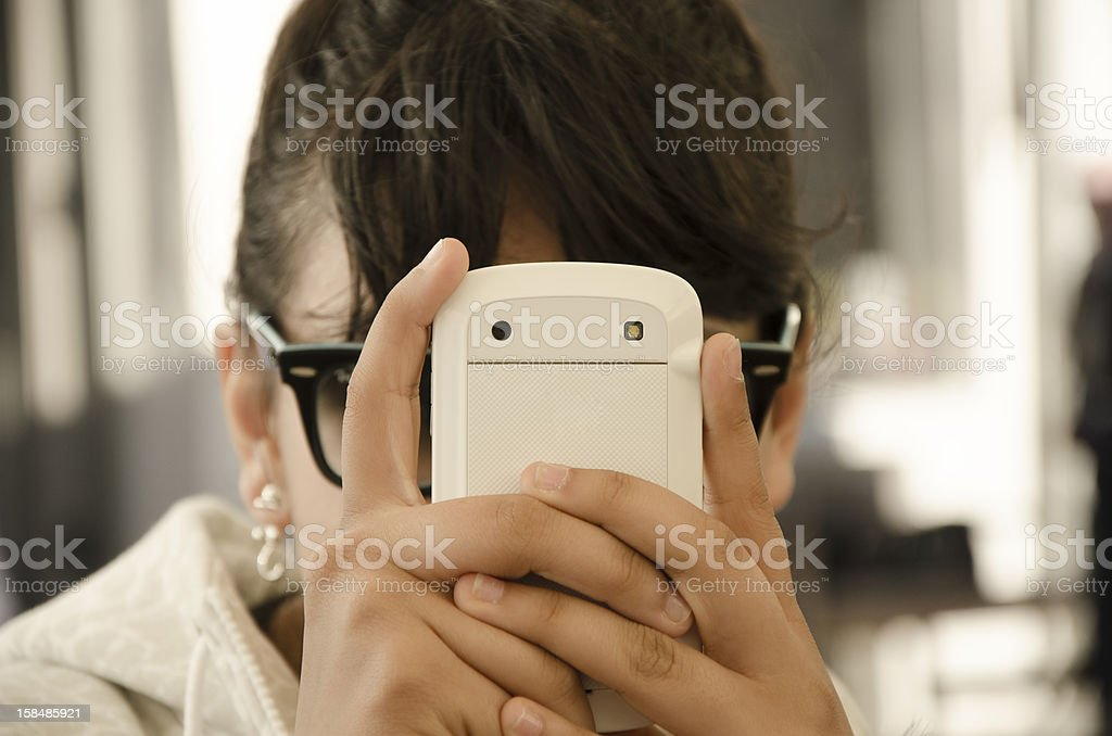 young girl and mobile phone royalty-free stock photo