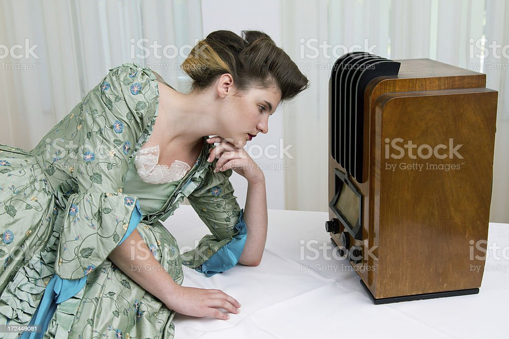 Young girl and old radio stock photo