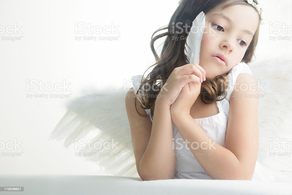 Young girl angel holding feather royalty-free stock photo