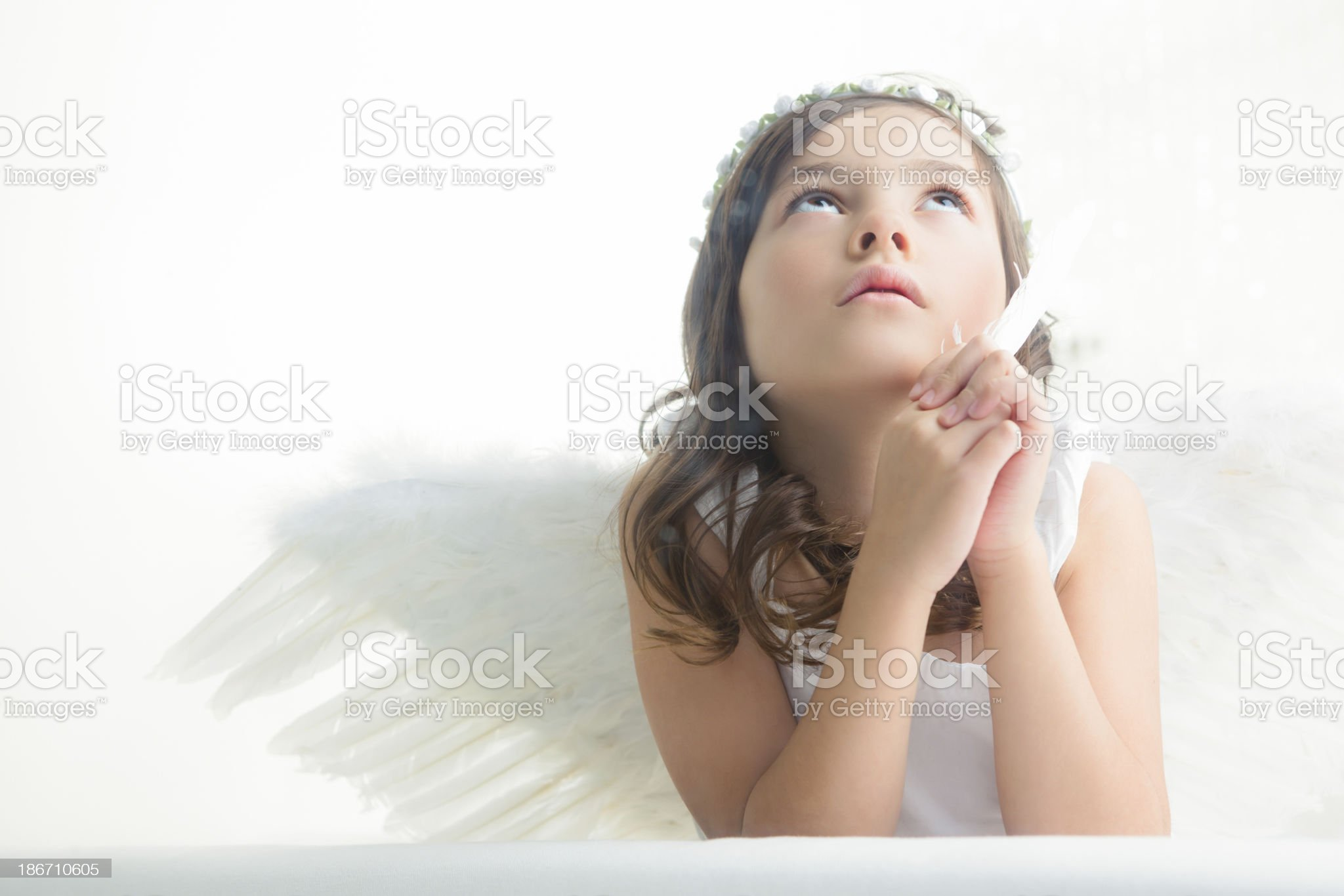 Young girl angel looking up royalty-free stock photo