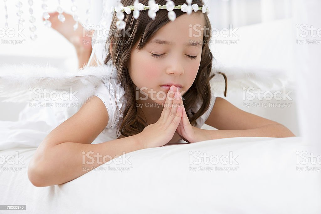 Young girl angel praying royalty-free stock photo