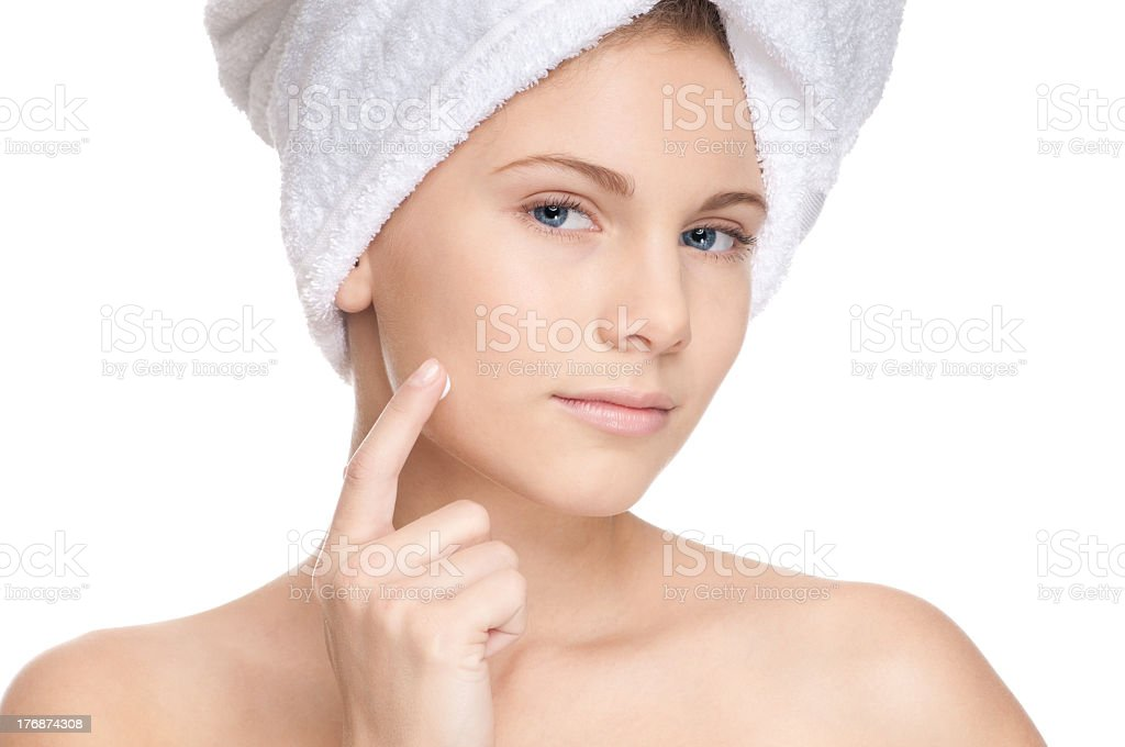 Young girl applying cream to her face royalty-free stock photo