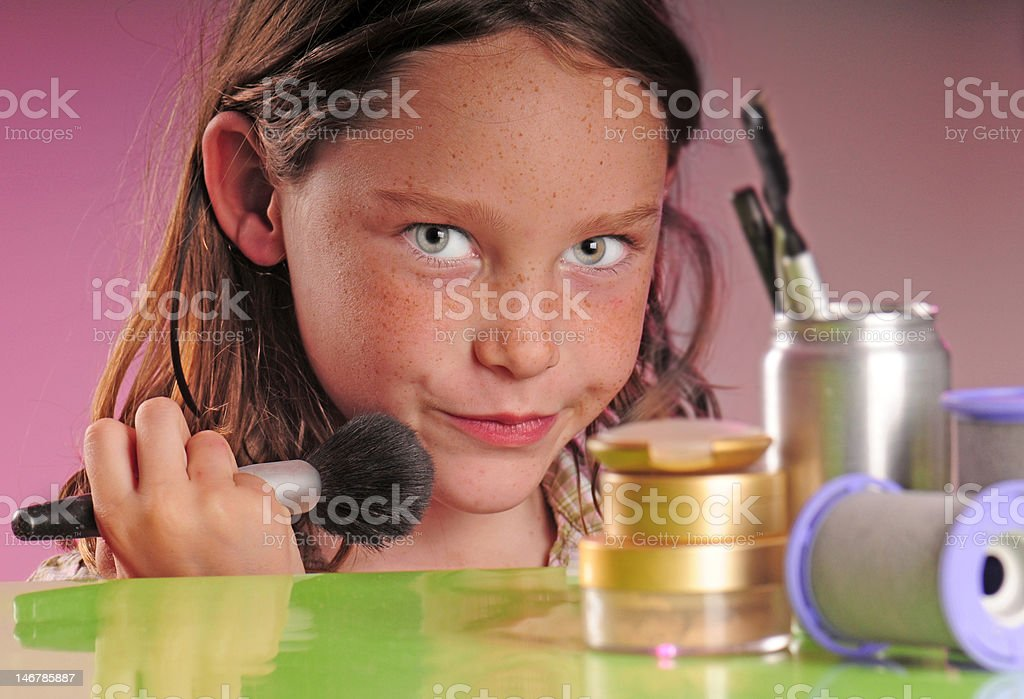 Young girl applying makeup royalty-free stock photo