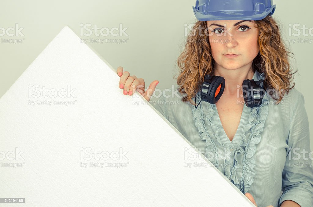 young girl  architect holding a sign or Styrofoam insulation stock photo