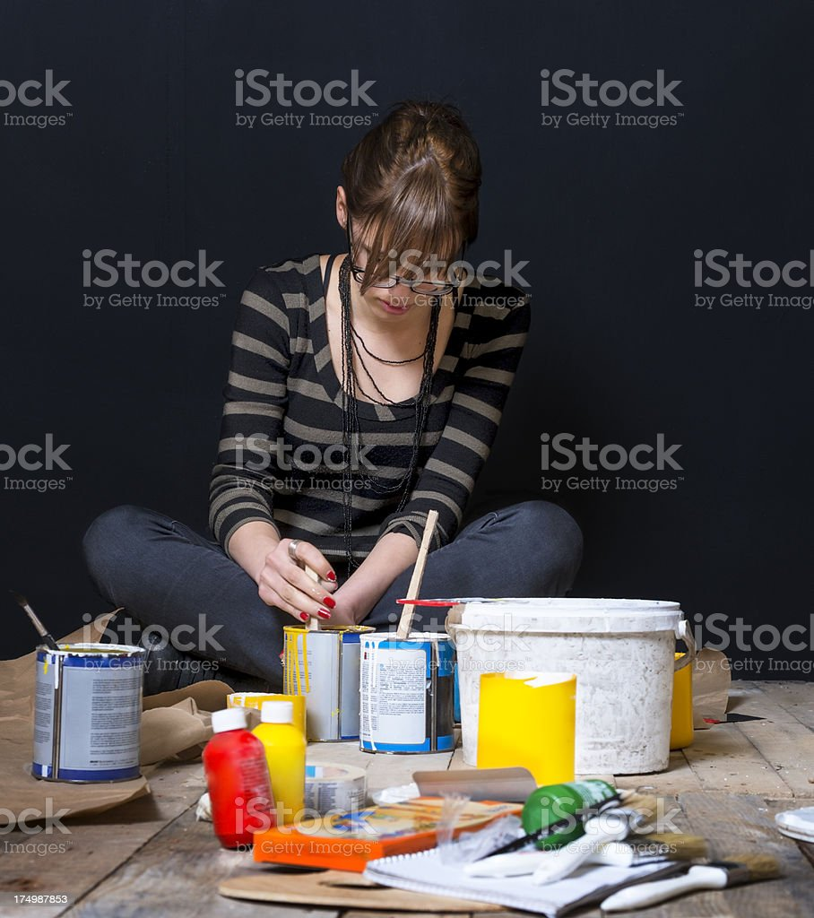 Young girl, artist, prepare colors for paining royalty-free stock photo