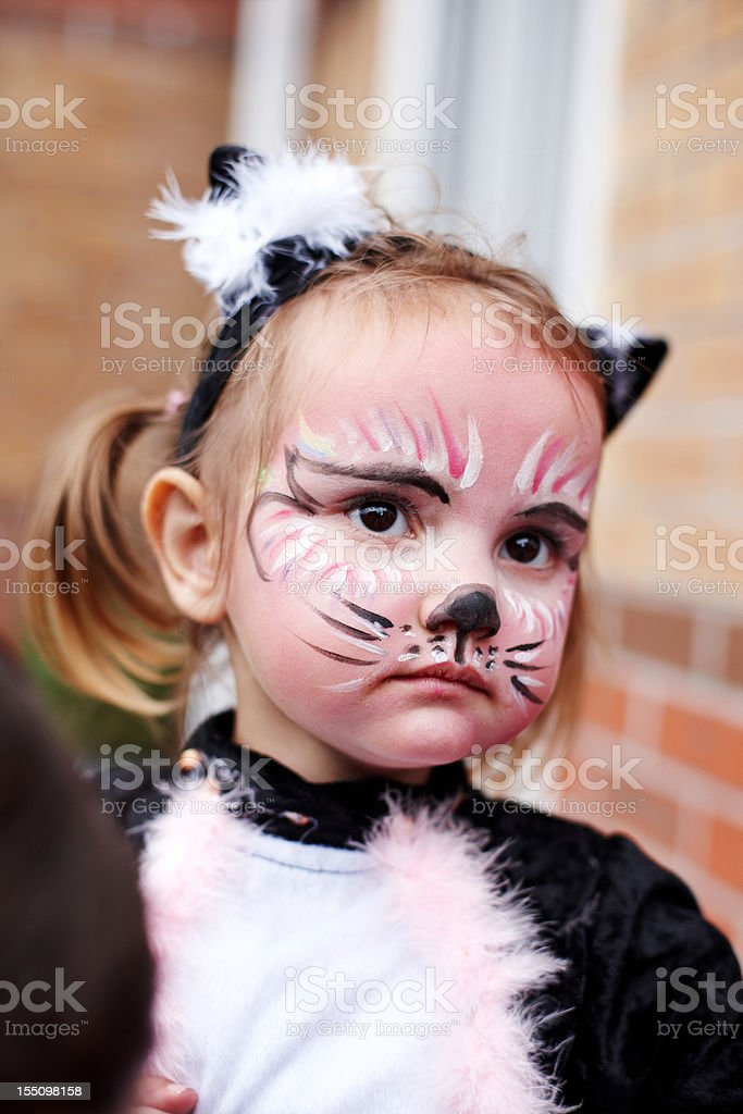 Young girl as face painted cat royalty-free stock photo