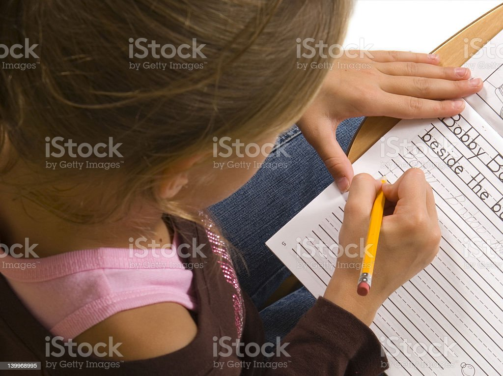 Young Girl at desk in school on white stock photo