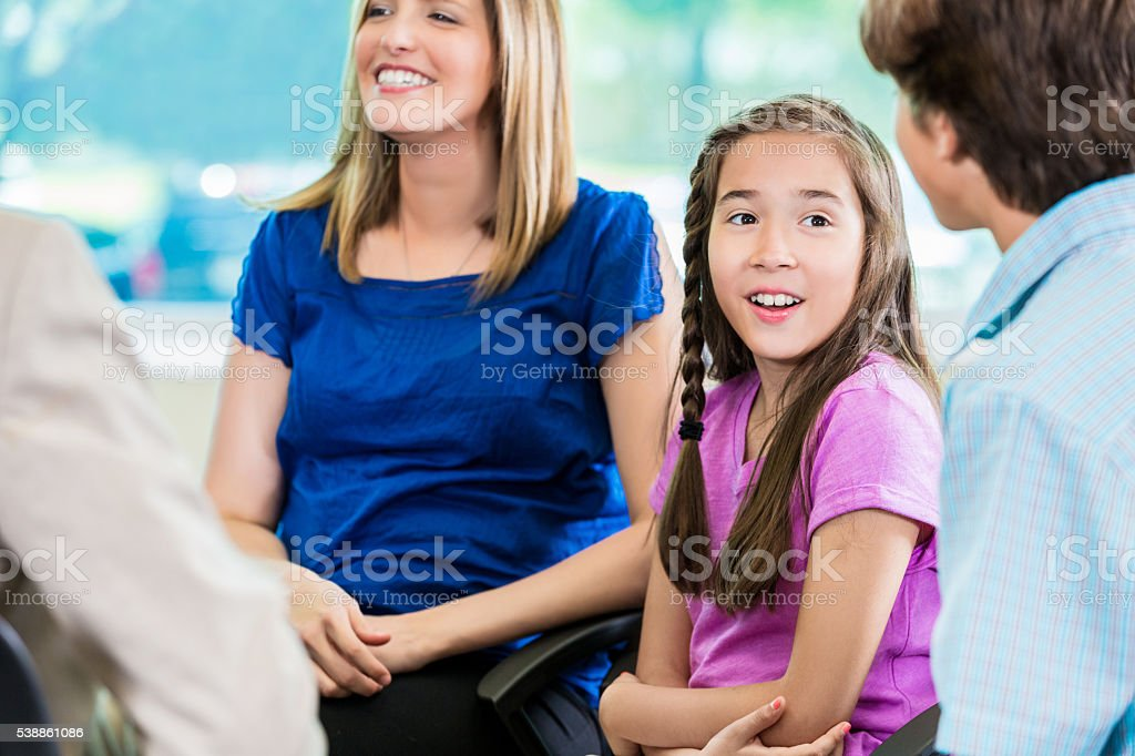 Young girl at meeting with family stock photo