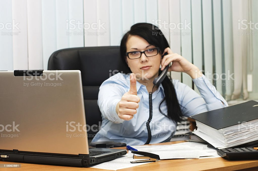young girl at office behind a table royalty-free stock photo