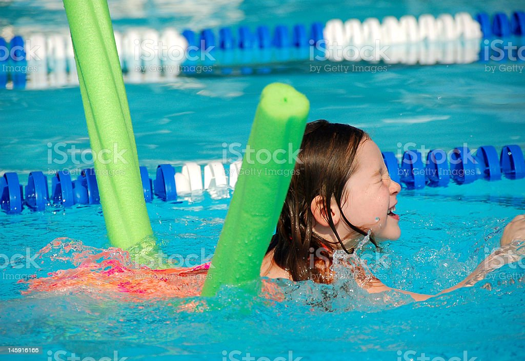 Young Girl at Swimming Lesson stock photo