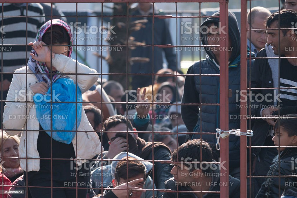 Young girl at the gate of Dobova refugee camp stock photo