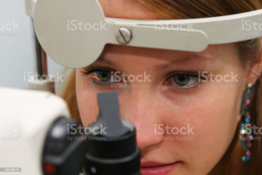 Young girl at the optometrist checking her vision stock photo