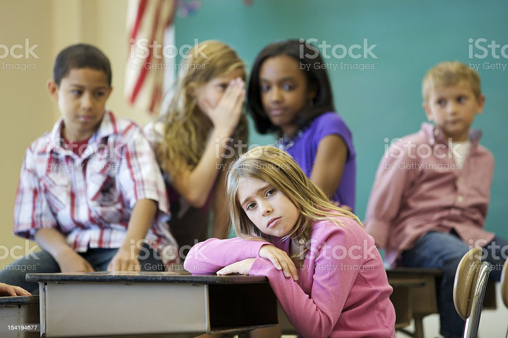 Young girl being bullied at School stock photo
