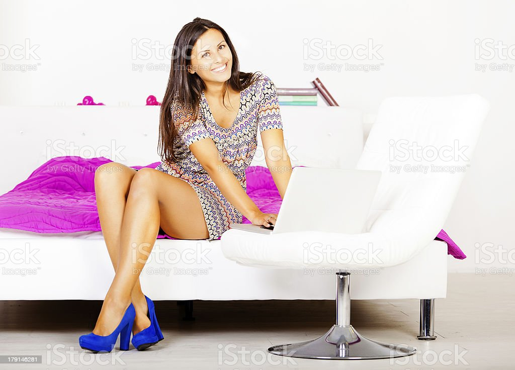 Young girl blogger typing on laptop royalty-free stock photo