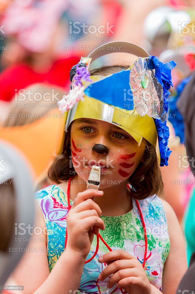Young girl blowing a whistle stock photo