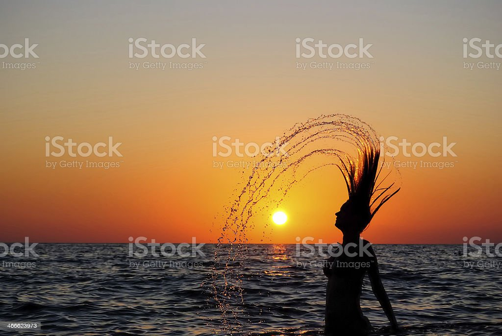 Young girl breaking out from sea stock photo