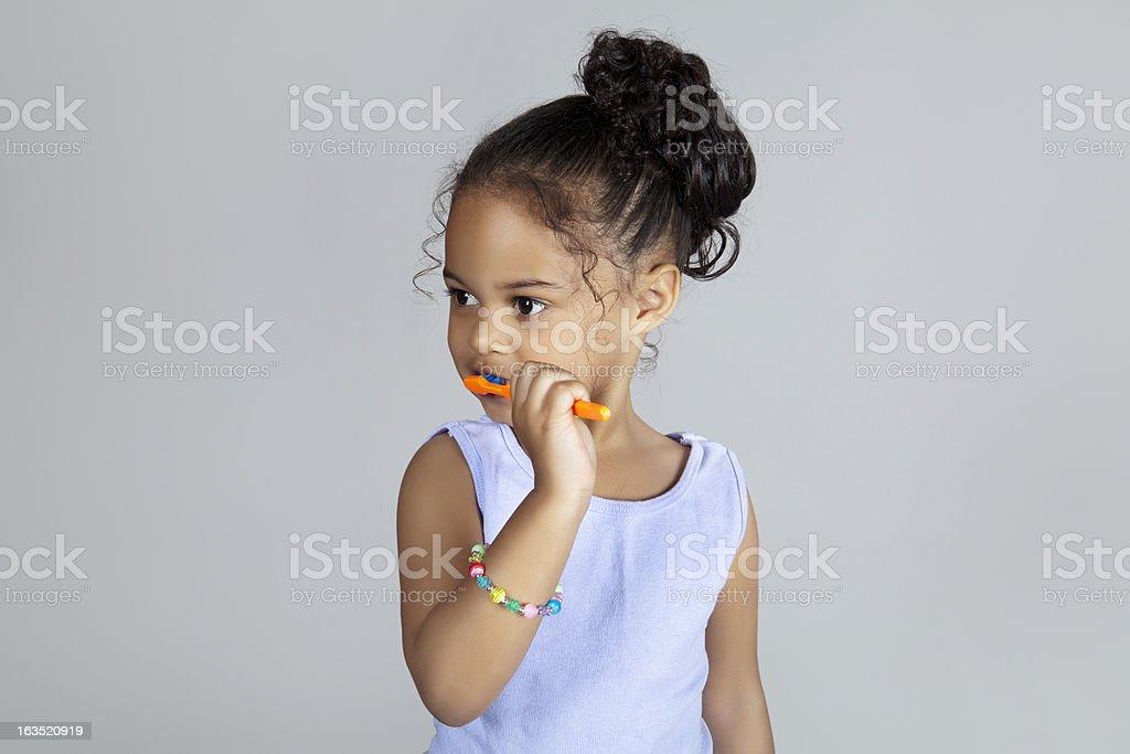 Young girl brushing teeth royalty-free stock photo